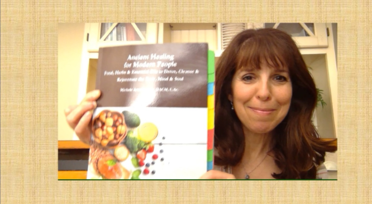 Dr. Michele Arnold with her book Ancient Healing