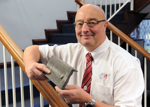AHT Sales Director Ian Perks with a part heat treated by Oven 30