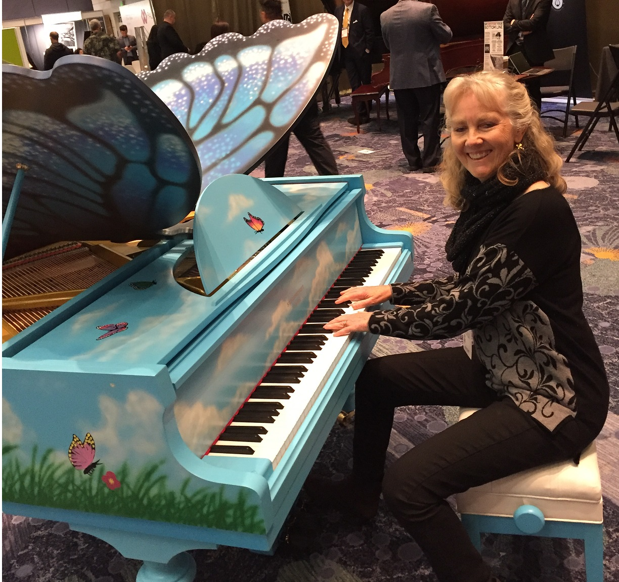 Playing a butterfly piano at NAMM