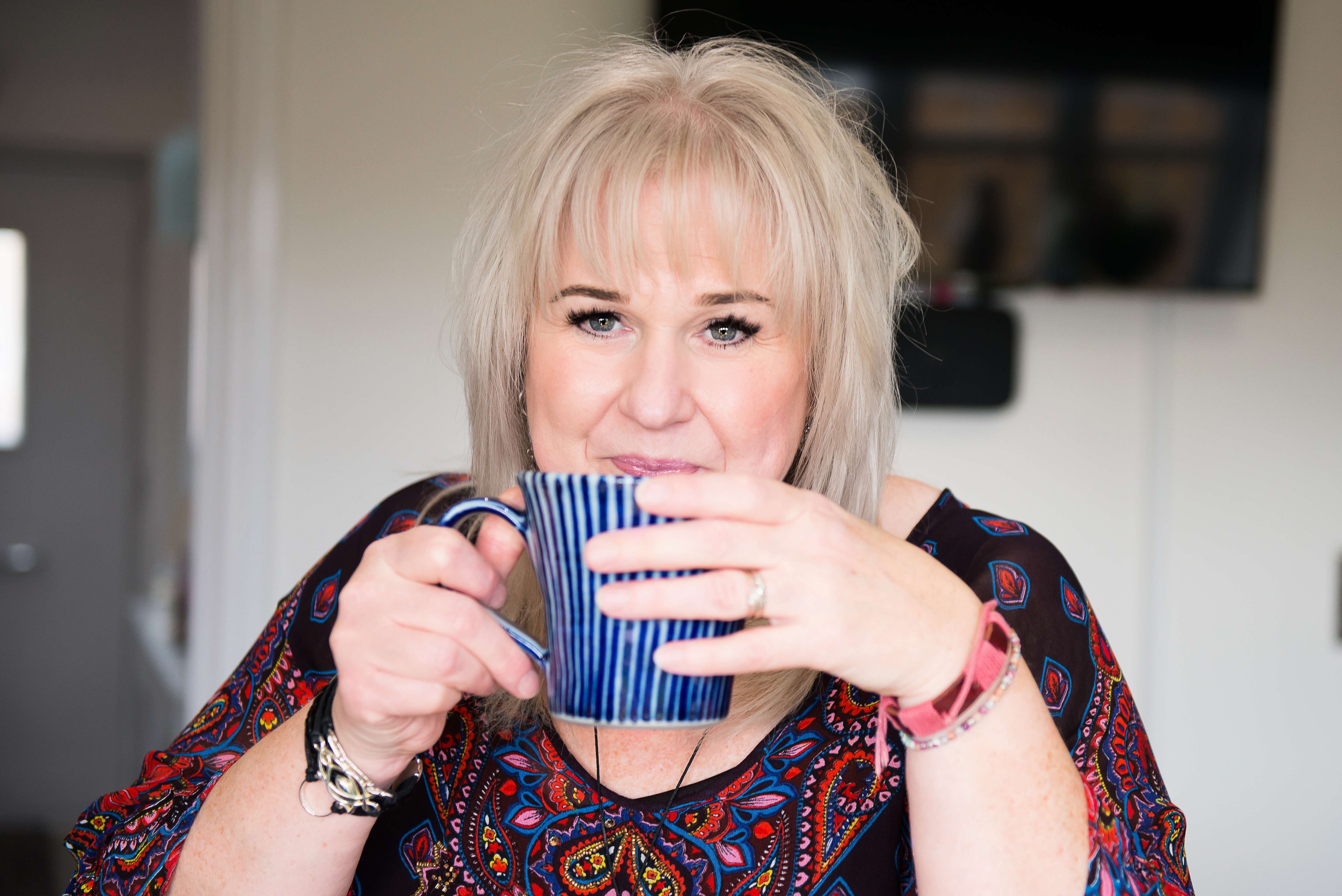 picture of a woman drinking a cup of tea