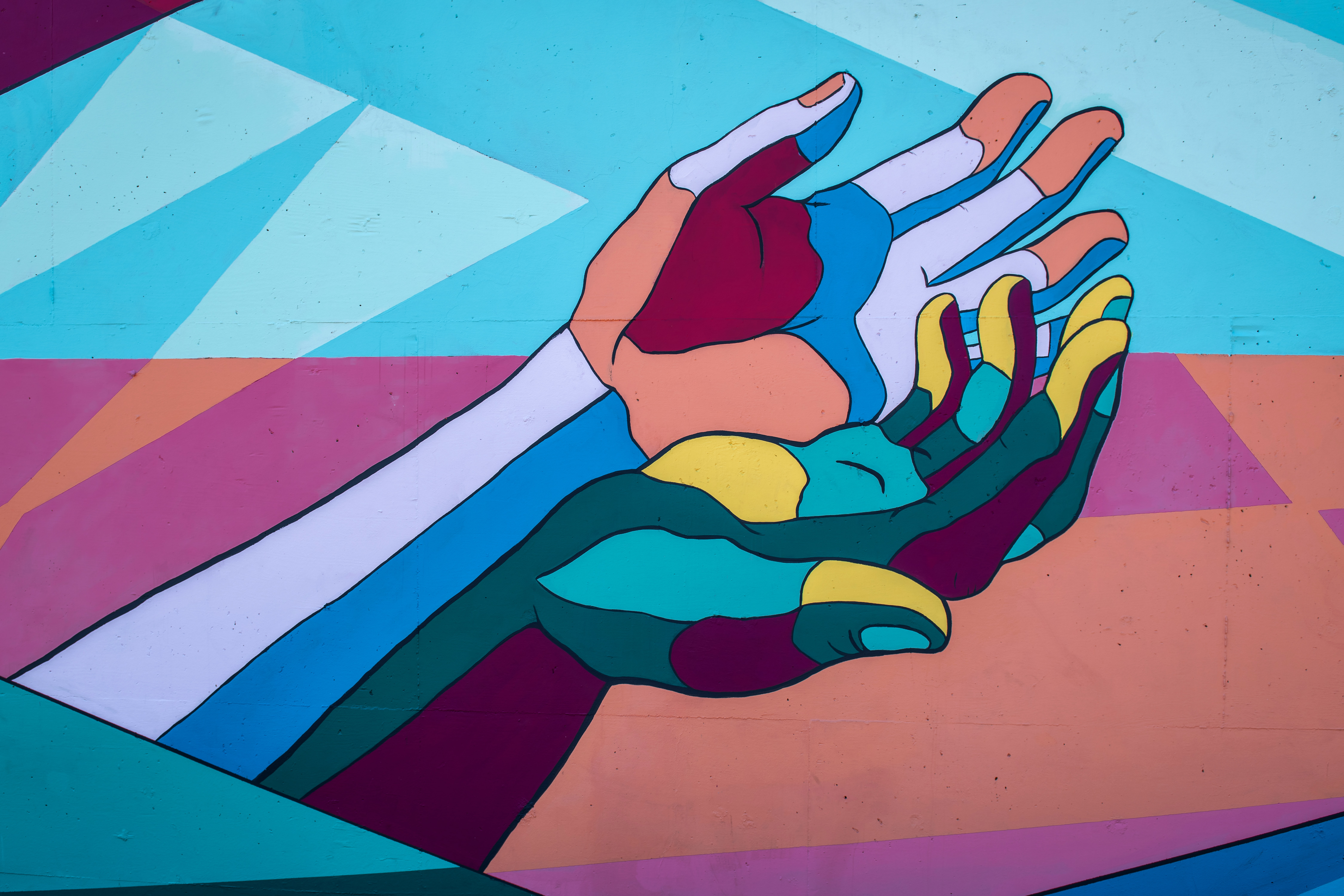 Image of painting of colorful open hands