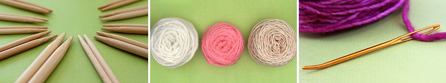 3 Balls of yarn in white, pink, and beige colors on a green background