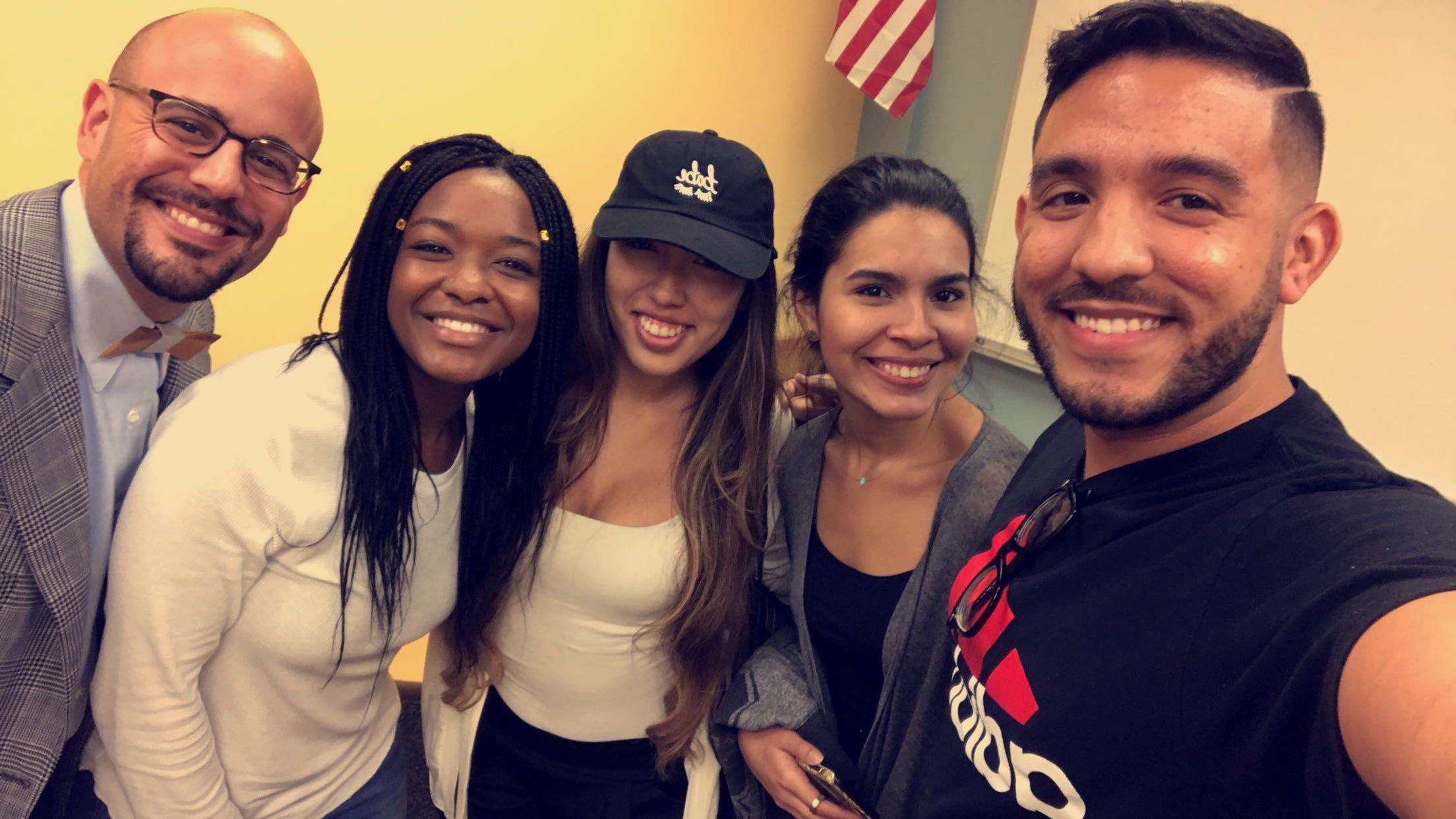 Professor Alfredo Garcia with an African American female university student, two Hispanic university students, and one Hispanic male university student