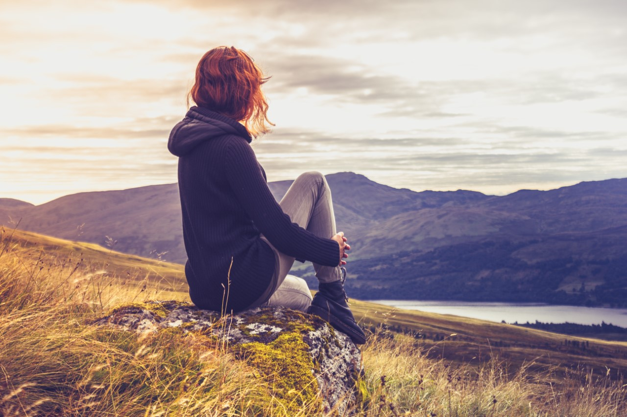Woman on a hillside in contemplation